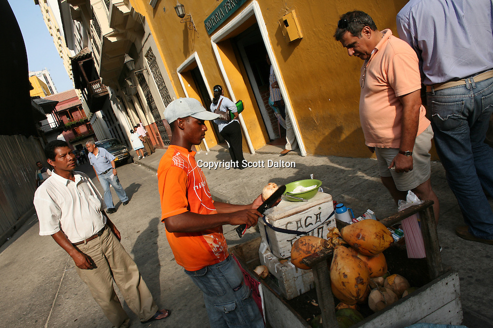 "A man sells coconuts on the street in the ""Old City"" in Cartagena, a unique travel destination on Colombia's Caribbean coast. (Photo/Scott Dalton)"