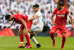 (L-R) Franco Vazquez of Sevilla FC, Marco Asensio of Real Madrid, Gabriel Ivan Marcado of Sevilla FC during the La Liga Santander match between Real Madrid CF and Sevilla FC on December 09, 2017 at the Santiago Bernabeu stadium in Madrid, Spain.