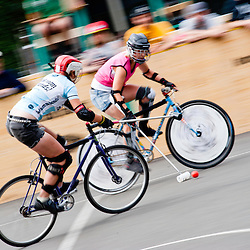 London, UK - 24 August 2012: two participants play during the Hell's Belles Vol 2, Ladies Bike Polo Tournament in Bethnal Green Gardens.