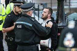 © Licensed to London News Pictures . 02/09/2019. Salford, UK. JAMES GODDARD is detained by police , and believed to have been arrested , and placed in to a police van after he and his supporters obstructed a car containing Jeremy Corbyn and John McDonnell following a Labour Party rally at the Lowry theatre in Salford . Photo credit: Joel Goodman/LNP