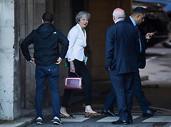 © Licensed to London News Pictures. 19/10/2019. London, UK. Former Prime Minister Theresa May smiles as she arrives at Parliament. Prime Minister Boris Johnson's new Brexit deal will be debated and voted on in an historic Saturday sitting today. Photo credit: Peter Macdiarmid/LNP