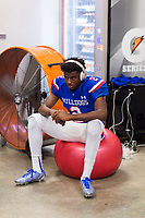 Folsom Bulldogs Caleb Nelson (2), sits by a fan gets as he gets ready inside the locker room before the game as the Folsom Bulldogs host the Jesuit Marauders,  Friday Sep 1, 2017. The Game was moved to Folsom from Jesuit due to the high temperatures. <br /> photo by Brian Baer