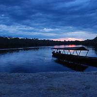Bongo en un atardecer en Boca de Autana; rio Autana, estado Amazonas, Venezuela. Bongo on a sunset in Boca de Autana; Autana River, Amazonas State, Venezuela.