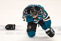 January 6, 2010; San Jose, CA, USA; San Jose Sharks defenseman Dan Boyle (22) is knocked to the ice after being hit in the face during the second period against the St. Louis Blues at HP Pavilion. San Jose defeated St. Louis 2-1 in overtime. Mandatory Credit: Jason O. Watson / US PRESSWIRE