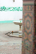MARRAKESH, MOROCCO - 19TH APRIL 2016 - Water fountain inside the Zaouia / zawiya burial tomb shrine site of Sidi Abdullah al-Ghazwani, Marrakesh, Morocco.