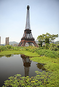 HANGZHOU, CHINA - AUGUST 07: (CHINA OUT) <br /> <br /> Replica Of Paris In China<br /> <br /> a replica of The Eiffel Tower standing at 108 metres at Tianducheng residential community, also known as a knockoff of Paris, on August 7, 2013 in Hangzhou, Zhejiang Province of China. Tianducheng is developed by Zhejiang Guangsha Co. Ltd.. The construction began in 2007 with a replica of the Eiffel Tower and Parisian houses, and it is expected to be completed by 2015. <br /> ©Exclusivepix