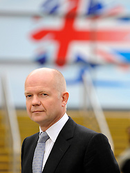 © Licensed to London News Pictures. 05/10/2011. MANCHESTER. UK. The Rt Hon William Hague MP, First Secretary of State for Foreign and Commonwealth Affairs taking part in early morning television interviews at The Conservative Party Conference at Manchester Central today, October 5, 2011. Photo credit:  Stephen Simpson/LNP