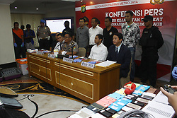 July 31, 2017 - Central Jakarta, Capital Region Of Jakarta, Indonesia - Indonesian Police held a press conference as well as showed the evidence, and presented 153 Chinese nationals who committed crimes of cyber in the form of telephone fraud at the Jakarta Metropolitan Police Headquarters on Monday, July 31, 2017. In cooperation with the Police of the People's Republic of China, the Indonesian Police successfully dismantled an international cybercrime syndicate with a telephone fraud mode by 153 Chinese nationals in Indonesia, spread across three major cities, Jakarta, Surabaya and Bali, with a turnover of IDR 20 trillion per year. (Credit Image: © Tubagus Aditya Irawan/Pacific Press via ZUMA Wire)