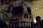 "People march with a big skull with the legend of ""Dissappeared"" protesting the disappearance of 43 students in Iguala, Guerrero."