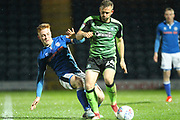 Callum Camps challenges David Fox during the EFL Sky Bet League 1 match between Rochdale and Plymouth Argyle at Spotland, Rochdale, England on 24 April 2018. Picture by Daniel Youngs.