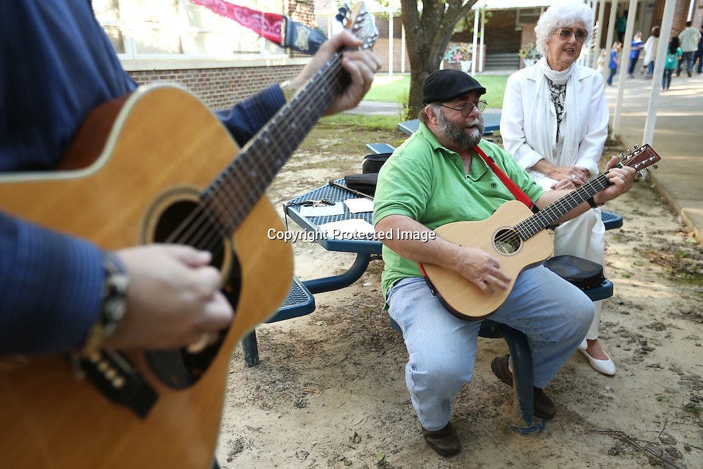 Adam Robison | BUY AT PHOTOS.DJOURNAL.COM<br /> Down South 78 band members,Brian West, left, James Pirkle and Jewel Ausborn, provide music outside during the Lawhon Arts Festival Monday night in Tupelo.