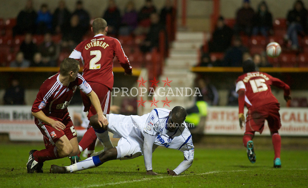 SWINDON, ENGLAND - Tuesday, January 25, 2011: Tranmere Rovers' Enoch Showunmi is brought down by Swindon Town's Andrew Frampton during the Football League One match at the County Ground. (Photo by Gareth Davies/Propaganda)