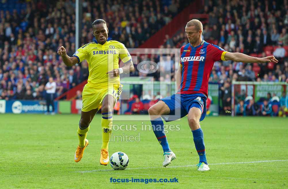 Didier Drogba of Chelsea and Brede Hangeland of Crystal Palace during the Barclays Premier League match at Selhurst Park, London<br /> Picture by Alan Stanford/Focus Images Ltd +44 7915 056117<br /> 18/10/2014