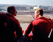 Pilots of the 'Red Arrows', Britain's Royal Air Force aerobatic team wave to seafront spectators from RAF Merlin helicopter.