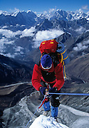 Mountaineer John Reed ascends fixed line during a winter ascent of Southwest Ridge of Ama Dablam (22,525 feet/6,867 meters) one of the most beautiful peaks in the Khumbu (Everest) Region of the Nepal Himalaya