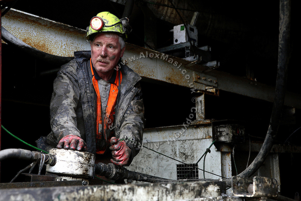 Heddwyn Williams, 52, is working to restore a broken mechanical carpet at Unity Mine on Thursday, Apr. 12, 2007, in Cwmgwrach, Vale of Neath, South Wales. The time is ripe again for an unexpected revival of the coal industry in the Vale of Neath due to the increasing prize and diminishing reserves of oil and gas, the uncertainties of renewable energy sources, and the technological advancement in producing energy from coal while limiting emissions of pollutants, has created the basis for valuable investment opportunities and a possible alternative to the latest energy crisis. Unity Mine, in particular, has started a pioneering effort to revive the coal industry in the area, reopening after more than 8 years with the intent of exploiting the large resources still buried underground. Coal could be then answer to both, access to cheaper and paradoxically greener energy and a better and safer choice than nuclear energy as a major supply for the decades to come. It is estimated that coal reserves in Wales amount to over 250 million tonnes, or the equivalent of at least 50 years of energy supply, while the worldwide total coal could last for over 200 years as a viable resource compared to only a few decades of oil and natural gas.