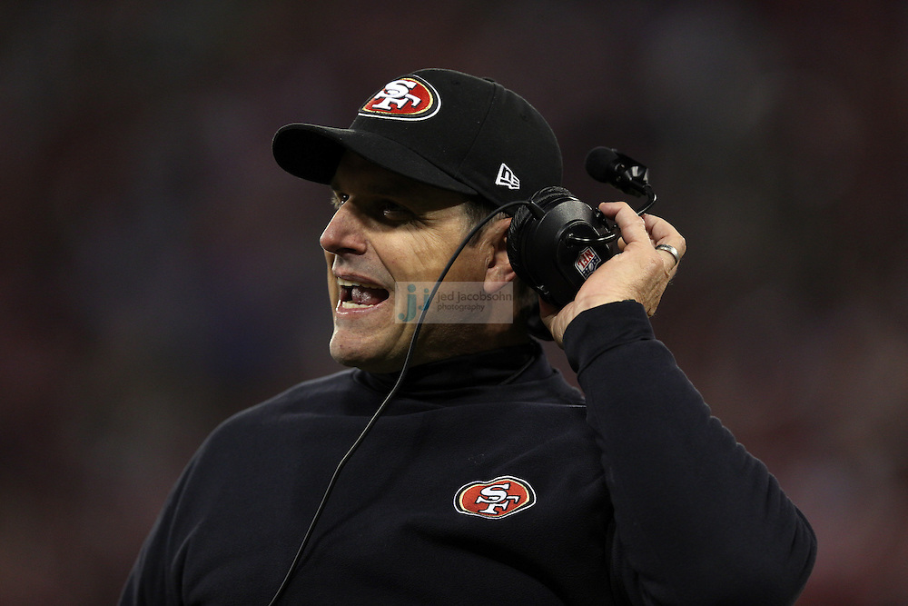 Head coach Jim Harbaugh of the San Francisco 49ers looks on during a NFL Divisional playoff game against the Green Bay Packers at Candlestick Park in San Francisco, Calif., on Jan. 12, 2013. The 49ers defeated the Packers 45-31. (AP Photo/Jed Jacobsohn)