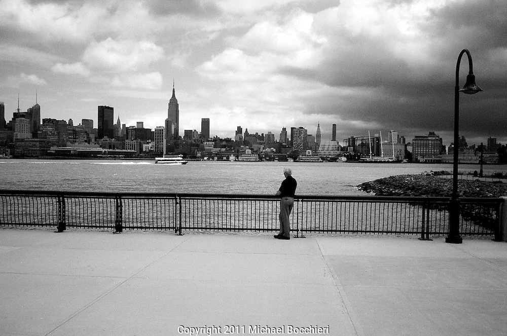 HOBOKEN, NJ - June 14:  A man stands by the Hudson River on June 14, 2011 in HOBOKEN, NJ.  (Photo by Michael Bocchieri/Bocchieri Archive)