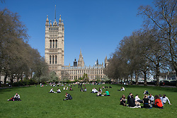 Workers and tourists in Westminster enjoy the warm weather, London, UK, May 1, 2013. Photo by: Daniel Leal-Olivas / i-Images