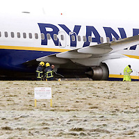 RyanAir jet at Prestwick Airport in Ayrshire sits on the grass after skidding off the runway after landing from a flight from Dublin in Ireland.  Picture Christian Cooksey