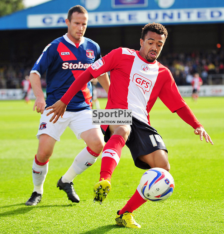 Nicky Ajose (Crawley Town, red) and Peter Murphy..Carlisle v Crawley, Npower League One, 29th September 2012..(c)  Alex Todd | StockPix.eu
