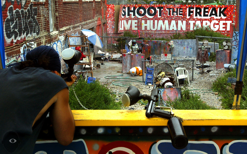 A bizarre shooting game on the boardwalk in Coney Island, NY, where one can shoot paintballs at a live target who moves about the enclosure.