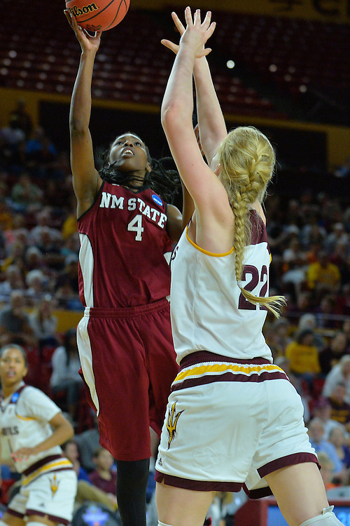 March 18, 2016; Tempe, Ariz;  New Mexico State Aggies guard Sasha Weber (4) puts up a shot over Arizona State Sun Devils center Quinn Dornstauder (22) during a game between No. 2 Arizona State Sun Devils and No. 15 New Mexico State Aggies in the first round of the 2016 NCAA Division I Women's Basketball Championship in Tempe, Ariz. The Sun Devils defeated the Aggies 74-52.