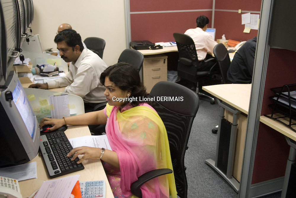 An Indian woman wears a traditional sari in the offices of Axiom telecom. Dubai, one of the seven emirates and the most populous of the United Arab Emirates sits on the southern coast of the Persian gulf.