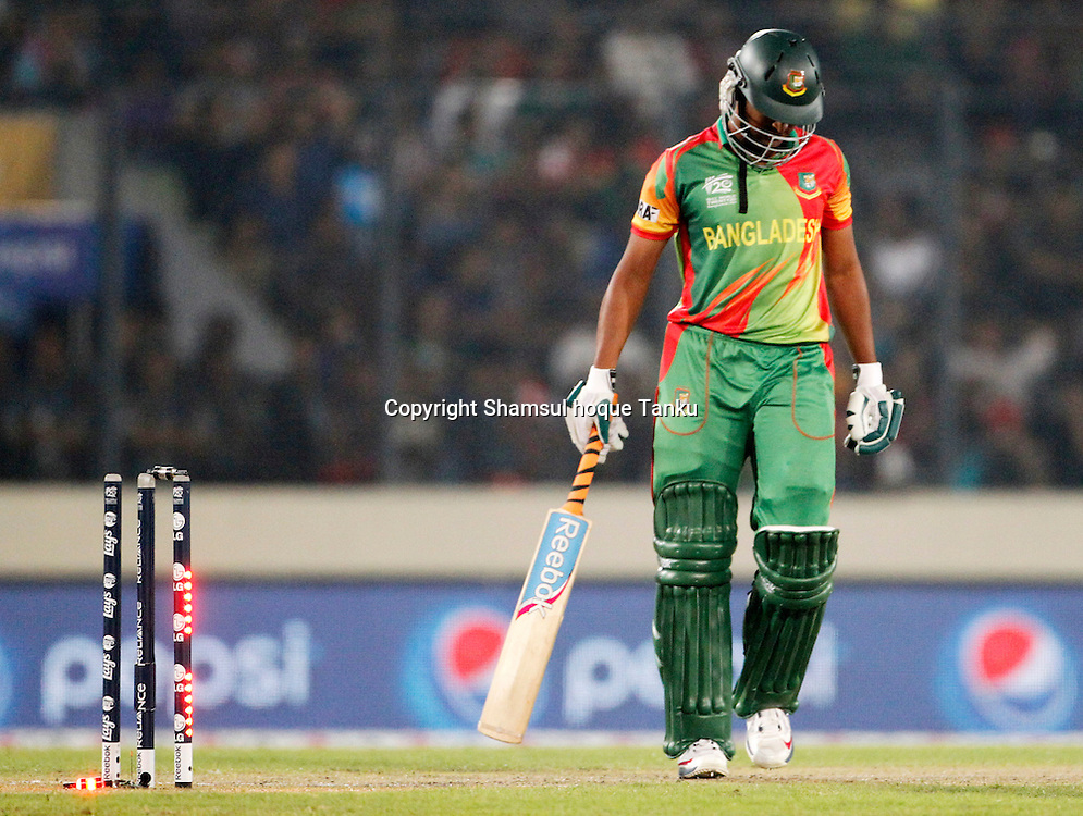 Shakib Al Hasan bowled by Kumar - Bangladesh v India - ICC World Twenty20, Bangladesh 2014. 29 March 2014, Sher-e-Bangla National Cricket Stadium, Mirpur. Photo: Shamsul hoque Tanku/www.photosport.co.nz