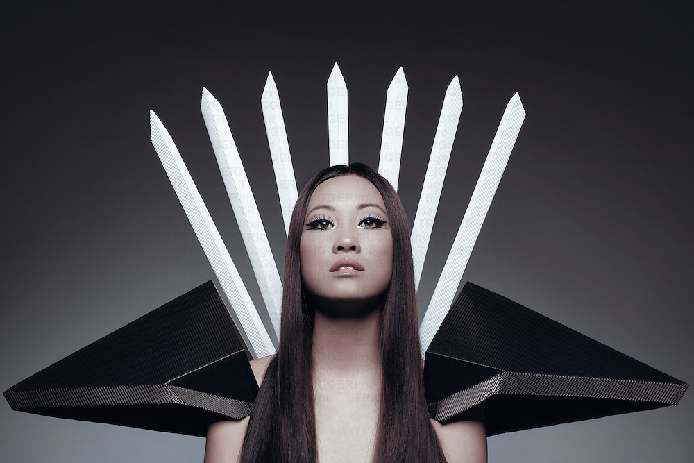 Female Asian model with long hair looking at camera with dramatic collar