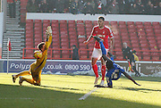 Clayton Donaldson scores his first and Birmingam's third during the Sky Bet Championship match between Nottingham Forest and Birmingham City at the City Ground, Nottingham, England on 28 December 2014. Photo by Jodie Minter.