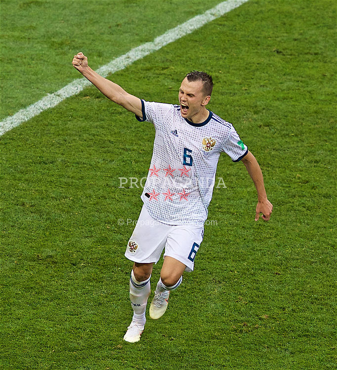 MOSCOW, RUSSIA - Sunday, July 1, 2018: Russia's Denis Cheryshev celebrates after scoring his side's fourth penalty in the shoot out against Spain, Russia won 4-3 on penalties after a 1-1 draw, during the FIFA World Cup Russia 2018 Round of 16 match between Spain and Russia at the Luzhniki Stadium. (Pic by David Rawcliffe/Propaganda)