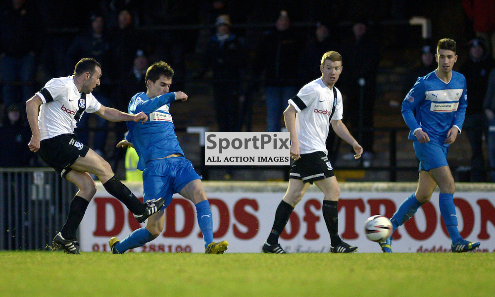 Michael Moffat of Ayr United (white shirt - 1st from left) shoots and scores his sides second goal of the game.<br /> Ayr United v Airdrie, Scottish League One, 11 January 2014<br /> &copy;Maurice Morwood/SportPix.org.uk