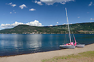 A small sailboat on the beach at Fintry Provincial Park in the Thompson Okanagan region of British Columbia, Canada