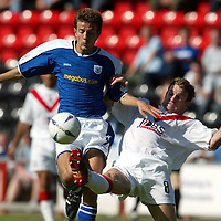 Airdrie v St Johnstone...07.08.04<br />Marvyn Wilson tackles Lee Hardy<br /><br />Picture by Graeme Hart.<br />Copyright Perthshire Picture Agency<br />Tel: 01738 623350  Mobile: 07990 594431