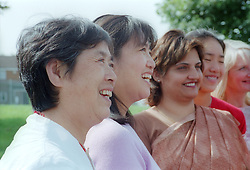 Multiracial group of woman smiling and laughing,