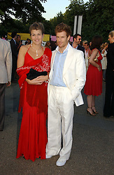 AMBER NUTTALL and TOM AIKENS at the Serpentine Gallery Summer party sponsored by Yves Saint Laurent held at the Serpentine Gallery, Kensington Gardens, London W2 on 11th July 2006.<br />