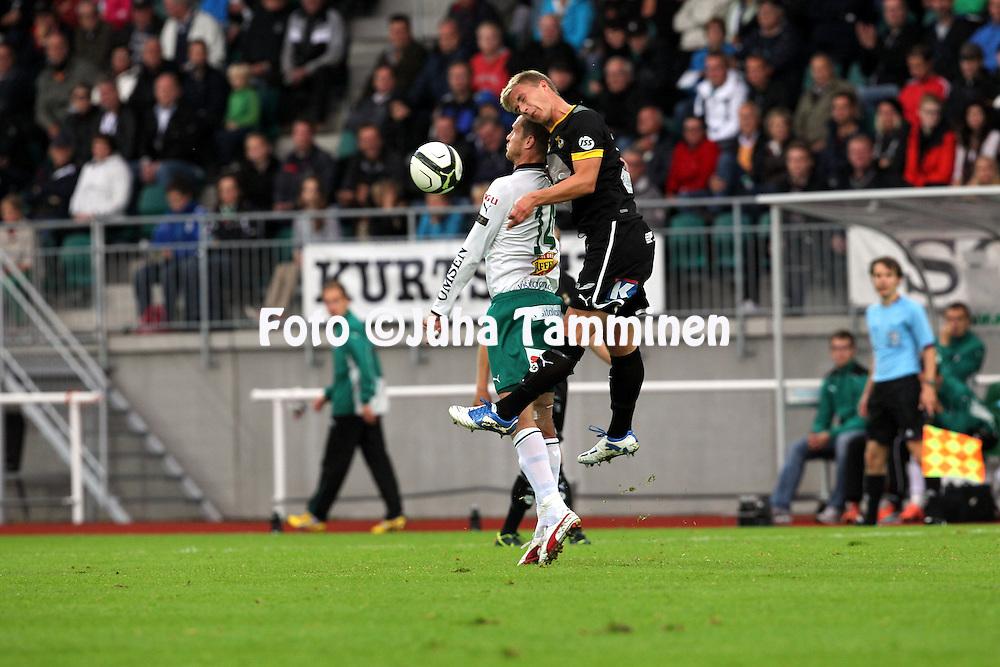 2.9.2012, Wiklof Holding Arena, Mariehamn / Maarianhamina..Veikkausliiga 2012..IFK Mariehamn - Kuopion Palloseura..Mattias Wikl?f (IFK Mhamn) v Ali Koljonen (KuPS).