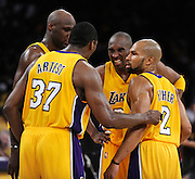 After Kobe Bryant was fouled in the final moments, he grimmaced while talking to Lamar Odom, Ron Artest and Derek Fisher as the considered a plan for the final seconds. The Lakers defeated the Boston Celtics in game 7 of the NBA Finals  83-79 in Los Angeles, CA 06/16/2010 (John McCoy/Staff Photographer).