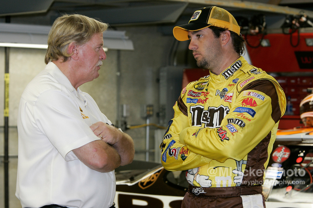 Pole sitter Elliott Sadler talks to car owner Robert Yates in the garages during practice for the Allstate 400 at the Brickyard.