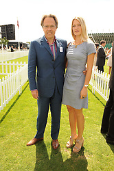 The EARL OF MARCH and his daughter LADY ALEXANDRA GORDON-LENNOX at the Cartier International Polo at Guards Polo Club, Windsor Great Park, Berkshire on 25th July 2010.
