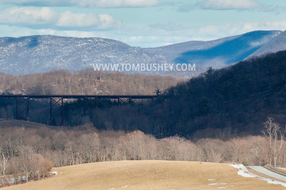 Cornwall, New York - View of the Moodna Viaduct railroad trestle and Schunnemunk Mountain on a windy winter afternoon on March 15, 2015.