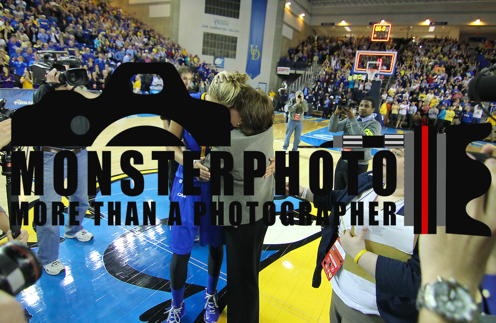 Delaware Forward Elena Delle Donne (11) and Delaware Women's Head coach Tina Martin embrace each other at center court after defeating North Carolina in the 2013 Women's NCAA tournament Tuesday, March 26, 2013, at the Bob Carpenter Center in Newark Delaware.