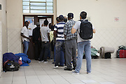 A queue of people in the main entrance hall of Missao Paz, São Paulo, Brazil.<br /> <br /> Missao Paz provides advice and support on employment, health, family, community and education. They also have residential quarters where people can stay when they have no where else. <br /> <br /> Their mission is to welcome, understand, integrate and celebrate the lives of immigrants and refugees, dreaming of a universal citizenship.