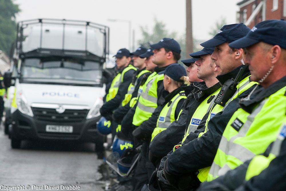 Police officers from as far away as county Durham were brought in to Police an EDL rally and UAF counter demonstration in Hexthorpe Doncaster South Yorkshire on Saturday. The EDL and UAF are thought to have chosen Hexthorpe after recent media reports of tension between newly arrived Roma residents and the the local community<br /> 19 July 2014<br /> Image © Paul David Drabble <br /> www.pauldaviddrabble.co.uk