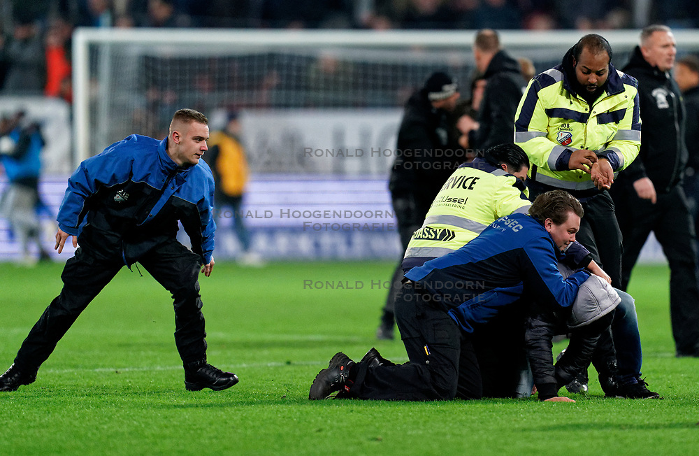 Supporters are stopped on the field by security the semi final KNVB Cup between FC Utrecht and Ajax Amsterdam at Stadion Nieuw Galgenwaard on March 04, 2020 in Amsterdam, Netherlands