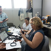 NOVEMBER , 2017&ndash;SAN JUAN, PUERTO RICO&mdash;<br /> NAHJ members Mc Nelly Torres and Rafael Mejia hand out satellite phones to journalists from the Centro de Periodismo Investigativo de Puerto Rico in an effort to help local journalists  better cover their communities. <br /> (Photo by Angel Valentin)
