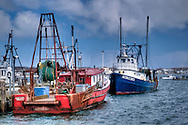 Two old Portuguese fishing boats at MacMillan Pier in Provincetown, Massachusetts.