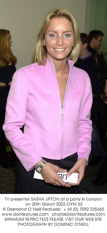 TV presenter SASHA UPTON at a party in London on 20th March 2002.	OYM 52
