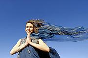 MR Yoga teacher and artist Lena Tancredi doing yoga on a the rocks of Ibiza